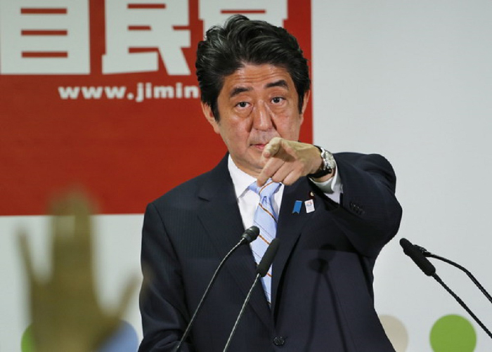 Japanese Prime Minister Shinzo Abe, president of the Liberal Democratic Party, points a reporter during a press conference in Tokyo, Monday, July 22, 2013. Abe has been striving since he took office in December to convince the public he has the wherewithal to lead a revival of the world's No. 3 economy. With the victory of his ruling coalition in Sunday's election for the upper house of parliament, he now must deliver on that promise. (AP Photo/Koji Sasahara)