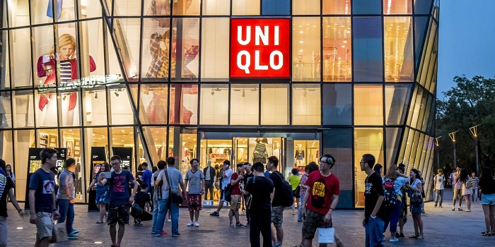BEIJING, CHINA - JULY 15:  (CHINA OUT) People walk by a Uniqlo outlet at Sanlitun after a sex video taken in what appears to be a Uniqlo store fitting room spread online on July 15, 2015 in Beijing, China. The video shot by a smartphone showed a young couple having sex in what appears to be a Uniqlo store fitting room. The Cyberspace Administration of China urged Sina and Tencent to increase their awareness of social responsibility, strengthen management and cooperate with the authority in investigating the case.  (Photo by ChinaFotoPress/ChinaFotoPress via Getty Images)