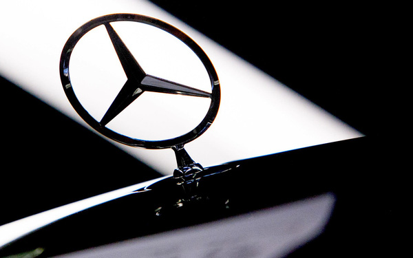 A hood ornament stands on a Mercedes-Benz S-Class automobile on the production line at the Daimler AG Mercedes-Benz factory in Sindelfingen, Germany, on Friday, Jan. 24, 2014.  Mercedes-Benz, the top selling luxury-car maker in the U.S., will likely decide by the end of next year on adding a second North American factory to boost capacity to meet rising demand. Photographer: Krisztian Bocsi/Bloomberg