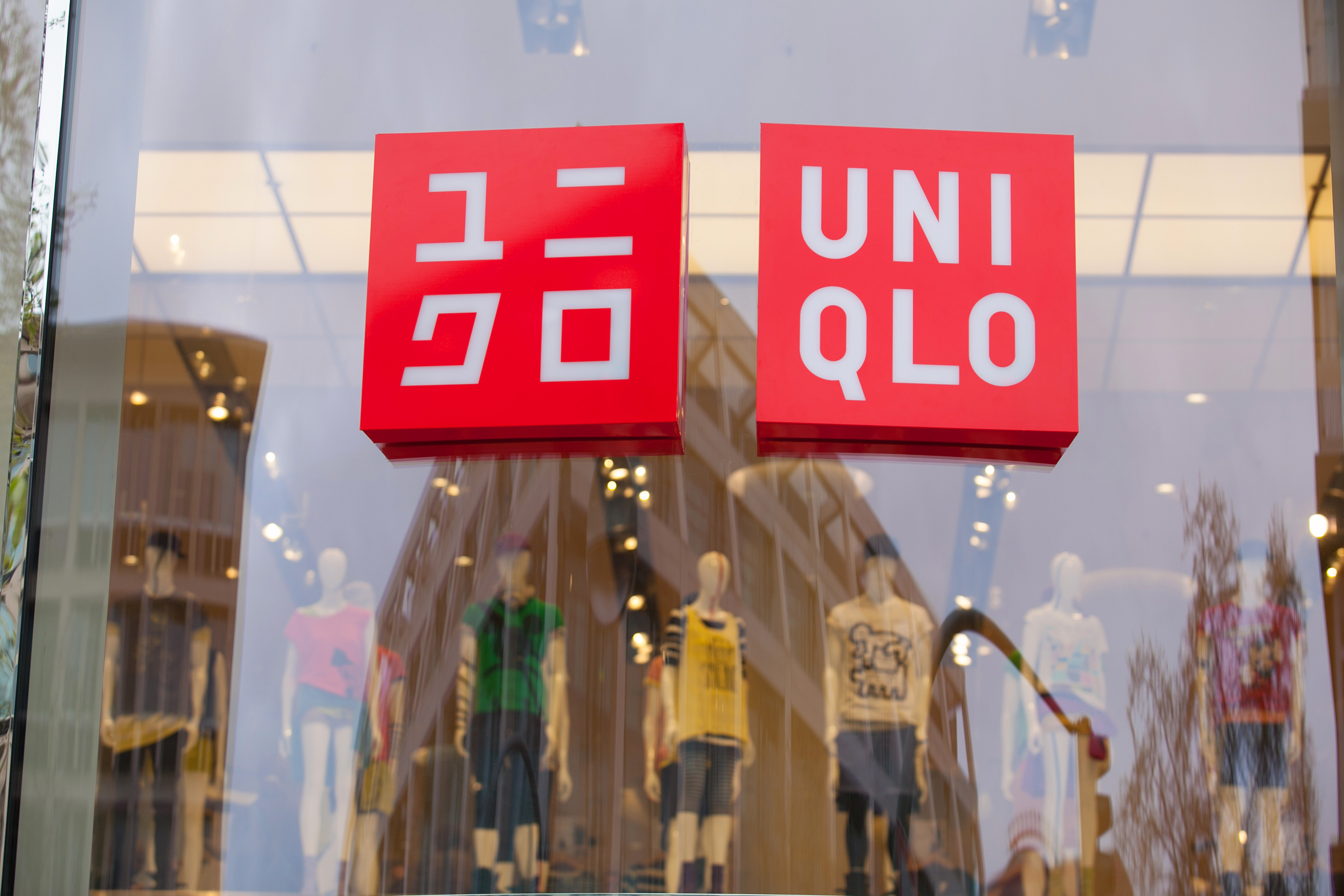 The logo of Uniqlo, the fashion clothing retailer operated by Fast Retailing Co., sits on display as the company opens their first German store in Berlin, Germany, on Friday, April 11, 2014. Fast Retailing, Asia's biggest clothing retailer, fell the most in 10 months in Tokyo trading after lowering its annual profit forecast, citing higher costs and weak demand. Photographer: Krisztian Bocsi/Bloomberg via Getty Images